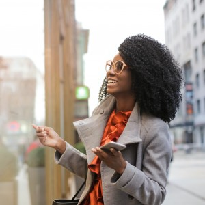happy-black-woman-laughing-on-street-3762927