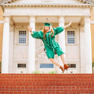 woman-jumping-above-stairs-wearing-graduation-gown-and-a-hat-2335298