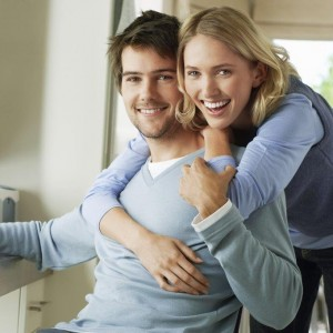 young happy couple in home office small